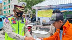 POLANTAS PEDULI, Satlantas Polrestabes Makassar Berbagi Paket Sembako